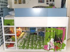 Grosgrain: IKEA Kura Bed Roundup So I think the bed is pulled out from the wall for this? Maybe I could push both beds together for a real cubby house underneath