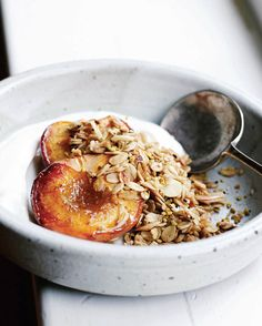 Beautiful Roasted Peaches with Easy Granola Recipe from @taraobrady of SevenSpoons.net found on leitesculinaria.com. Breakfast is served! #granola #summertime #cleaneating