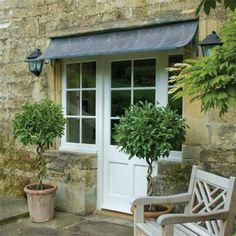 Design Element: Metal and Canvas Awnings- http://www.garden-requisites.co.uk/door-canopies