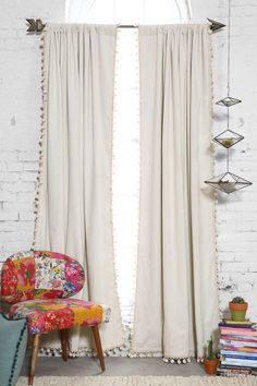 Plum & Bow Blackout Pompom Curtain I like the ivory. Make me some or buy these.