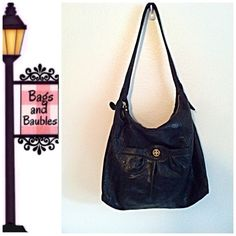 """Nice! TORY BURCH Black Leather Slouchy Hobo Very Good Pre-Loved Condition!! Textured leather TORY BURCH  slouchy hobo features gold tone stacked T logo on front pocket with magnetic closure, zip top closure, strap with 12"""" drop. Tan fabric lined interior with key clip, zip pocket and slip pockets. Includes (plain) dust bag. Note, minor tear on strap. Measures 14""""H x 14"""" W x 4""""D. Check closet for availability of similar bag in tan.  [#15]  Always Authentic 