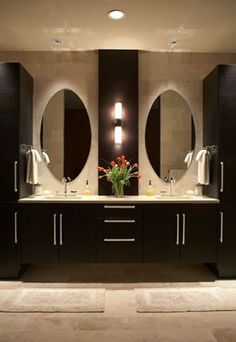 This bathroom leaves me breathless. Beautiful lit mirrors, striking contrast and exotic feel.