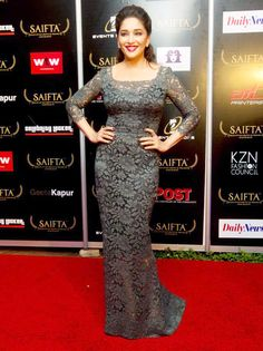 Madhuri Dixit wore a pretty ash grey gown looking beautiful on the red carpet at SAIFTA #Bollywood #Fashion #Style