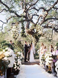 Ceremony with Floral-Adorned Oak Tree | Photography: Braedon Photography. Read More: http://www.insideweddings.com/weddings/rustic-elegant-celebration-on-ranch-in-bakersfield-california/606/