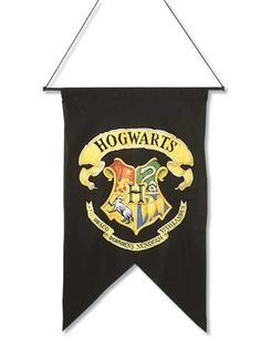 Give your school crest a place of honor with this Hogwarts Banner. | Community Post: 23 Things You Need For A Magical Harry Potter Dorm Room