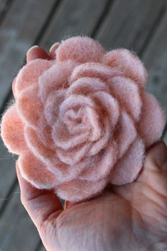 needle felted flower, use hand carders to fluff up the edges, needle fibers back into the pedal to create a softer edge