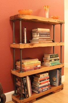 Reclaimed wood bookcase in a clear finish, metal accents in a brushed silver finish with 4 heavy duty shelves