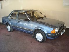 Ford Orion, ninth car owned, ours was a dark metallic red.