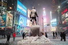 Snow and lights in Times Square during winter storm Nemo in midtown Manhattan,  February 8, 2013. Vivienne Gucwa.