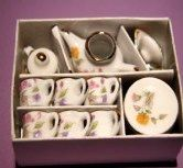 Porcelain or china dishes.  Sold in KITCHEN MINIATURES on website http://barbspencerdolls.com
