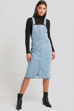 This dress features a dungaree design, a midi length, adjustable shoulder straps, two front pockets, an open bottom hem and button closures down the front. Denim Midi Dress, Denim Overall Dress, Blue Midi Dress, Overall Shorts, Blue Dresses, Midi Skirt, Salopette Jeans, Overalls Fashion, Window Boxes