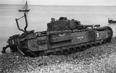 "A Churchill Mark III of 10 Troop ""B"" Squadron, The Calgary Regiment, immobilized on the beach at Aug 1942"
