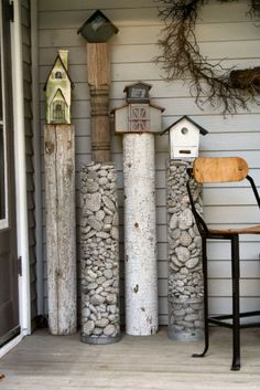 Pedestals made from chicken wire secured and filled with stones. Logs cut add more texture to the pedestals.