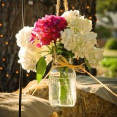 Flowers:: hang jars with flowers on posts, trees, or sit on multi level area. Easy to spread the color around with flowers.