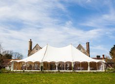Exterior view of the Oyster Pearl tent during daytime