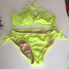 Jcrew neon green bikini Jcrew neon green side tie bikini bottoms, halter top, w/out tags but never worn, XS bottoms, S top J. Crew Swim Bikinis