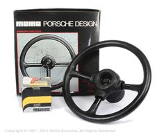 Lot 2144  Momo Porsche design 340mm steering wheel with removable centre hub protector and fitted with Talbot Boss adaptor. Condition is generally Good Plus to Excellent with Fair to Good boxes.  Estimate: £100 - £120