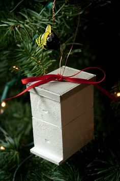 Handmade Langstroth-style beehive ornament. If you are a beekeeper or know one, this cute little hive ornament is a fun Christmas decoration that can