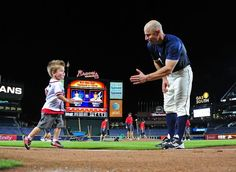 Reed Johnson greets his son Tyce after running the bases after the game!