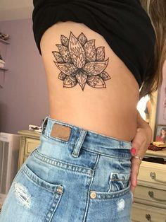 Mendhi style lotus flower tattoo