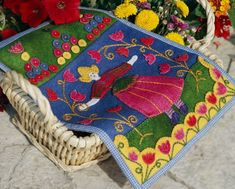 For a project on the go, take along this folk art-inspired embroidered wool  mat. It makes a perfect stitch sampler, too.