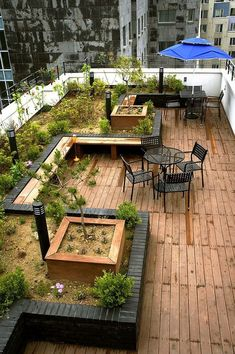 Exterior Design,Charming Rooftop Garden Design Ideas With Slatted Wooden Floor And Greenery Featuring Black Iron Tables And Chairs And Complete With Blue Umbrella,Beautiful Modern Rooftop Garden Design Inspirations Amazing Rooftop Porch and Balcony Design Rooftop Terrace Design, Terrace Garden Design, Small Terrace, Rooftop Patio, Patio Design, Sky Garden, Small Patio, Terrace Ideas, Wooden Terrace
