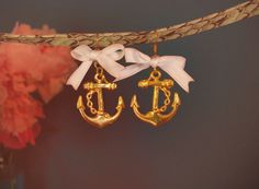cute anchor earrings...better without the bows though...