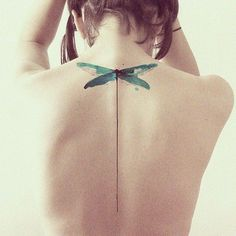 Minimalist green dragonfly tattoo on back for women