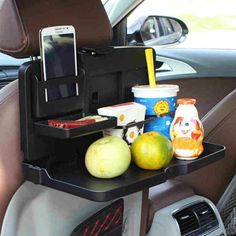 Multipurpose Handy Car Food Tray for Headrest | Brats On Board | This Multipurpose Handy Car Tray is constructed with 2 cup holders, an enclosed pocket, a mini flat surface and a large flat surface. The tray also has a hook all the way on the bottom so that you can hang your groceries, handbag school bag or any other bag. #CarDining #EatingInCar #RoadTripHacks