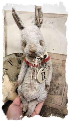 "~~~~ A New Rabbit Design ~~~~ One of a Kind ""R"" Is for RABBIT - Old Pale Blue/Gray Hare handmade by Wendy Meagher of Whendi's Bears - A NEW Original ONE OF A KIND DESIGN ***Aprrox. 10"" Tall (12"" to tip of ears) - Antique Style Old Pale Blue/Gray color Rabbit, collar from vintage flag with grommet; a Double-Sided vintage poker chip charm with R on one side and vintage ABC Blocks graphics on the othe..."
