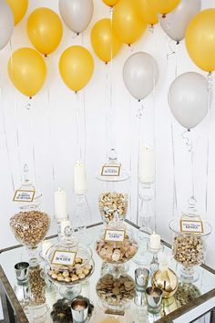 love the use of balloons, candles, and apothecary jars