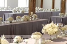 white wedding flowers in silver mercury vases down long wedding reception tables by AntebellumDesign.com