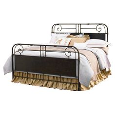 Perfect for Sunday morning sleep-ins and late-night reading, this charming bed features scroll detailing and turned posts.  Product: ...