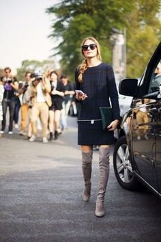 Olivia Palermo Make a navy plaid shift dress your outfit choice for a trendy and easy going look. Elevate your getup with grey suede over the knee boots. GET THIS LOOK: Navy Plaid Shift Dress Grey Suede Over The Knee Boots Dark Green Leather Clutch Dark Brown Sunglasses