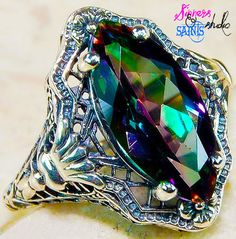 Amazing Mystic Topaz in stamped 925 GENUINE Sterling silver. Not plated, not made in China. Made right here in the USA.