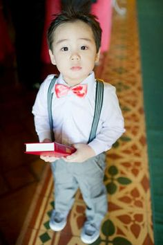 The ring bearer looked lovable in suspenders and a coral bow tie. Wedding Party Hair, Wedding Groom, Dream Wedding, Wedding Day, Wedding Dress, Wedding Planner, Destination Wedding, Coral Bridesmaid Dresses, Party Hairstyles