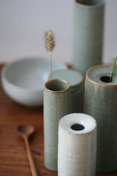 Florian Gadsby vases and bud vases. Green and white guan type glaze, reduction fired and crash cooled.