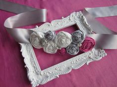 So pretty! Rosette Wedding Sash for Bride, Bridesmaid, or Flower Girl in Pink, Grey, and Ivory. $40.00, via Etsy.