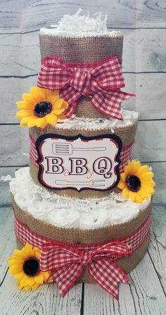 Baby Shower Ideas Discover 3 Tier Diaper Cake - BBQ Baby Q Diaper Cake - Burlap and Red Checker Diaper Cake Fall Theme Baby Shower Centerpiece Baby Q Shower, Baby Shower Diapers, Baby Shower Cakes, Baby Shower Diaper Cakes, Baby Shower Barbeque, Baby Shower Ideas For Girls Themes, Baby Ideas, Picnic Baby Showers, Baby Gender Reveal Party