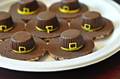 Pilgrim Hat Cookies:  Keebler Fudge striped cookies upside down, yellow decorating icing, small Reese's Pieces