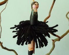 This is a lovely peg doll Christmas fairy / ballerina ornament.    It would look fab in your home on your Christmas tree, and would also make a gorgeous gift for friends or family.    Each 10.5cm wooden peg doll has a face and hair hand-painted with acrylic paint, painted glitter hair and dress decoration and an acrylic wool pom-pom ballerina tutu dress. The white wool contains strands of shimmering glitter. A 10cm white satin ribbon is attached to each doll to suspend it.    Dolls are m...