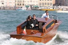 U2 frontman Bono was among the guests that attended the wedding of George Clooney and Amal Alamuddin in Venice, Italy. The singer looked like he was caught up in the romance as he was seen embracing his wife Ali Hewson while speeding down the Grand Canal in Venice on Sept. 29, 2014.