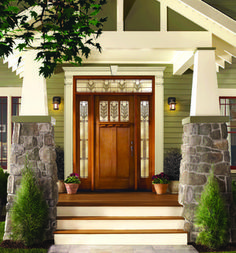 Wow, beautiful Craftsman bungalow with gorgeous transom and sidelights. Would keep the door solid with accent windows around