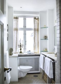 I like the marble shelf under the window that covers the radiator, and runs over the top of the toilet.