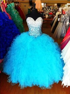turquoise blue rhinestone quince dress posted by elegantbrideandquince on instagram