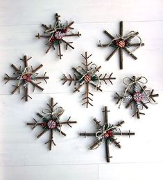75 DIY Christmas Ornaments Your Family Will Treasure for Years These charming crafts are made with twigs and decorated with button stickers, pine needles, berries, twine, and felt. They can even be used for festive wall art this holiday season. Easy To Make Christmas Ornaments, Diy Christmas Snowflakes, Homemade Christmas Presents, Christmas Crafts For Adults, Homemade Christmas Decorations, Christmas Ornaments To Make, Simple Christmas, Christmas Diy, Snowflake Ornaments