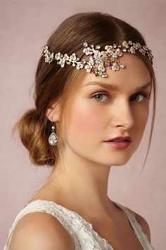 Tiny enamel flowers handpainted in a delicate blush hue are accented by clear and topaz Swarovski crystals set by hand in this headpiece from Debra Moreland. Constructed of eleven moveable sections, this special piece can be worn in several different ways, from halo to headband.