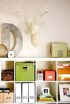 so many things!!! antlers, big chrome letter, and beautifully styled IKEA shelves