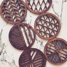 Laser cut laser engraved geometric wooden coasters in oak