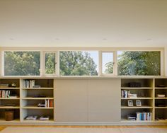 Fresh Wooden Details in the Home: Contemporary Bookshelf Southampton House Bedroom Glass Window